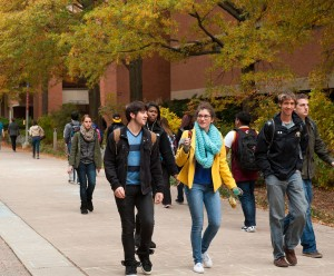 Students walking down Academic Row on Main Campus during Fall